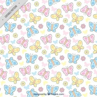 Padrão de mão desenhada borboletas e flores