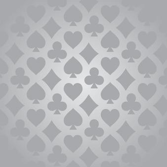 Padrão de naipes de cartas de jogar em fundo cinza
