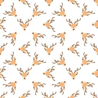 Padrão de natal com cabeças de renas em um fundo branco. ilustração vetorial