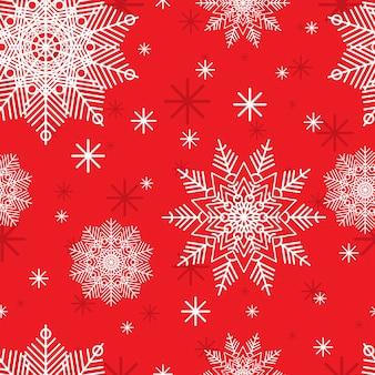 Padrão de natal com flocos de neve brancos sobre fundo vermelho