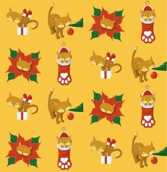 Padrão de natal com um gato brincando com elementos de natal