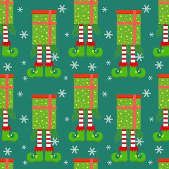 Padrão de natal sem costura com pernas de duende em caixa de presente