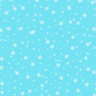 Padrão de neve. flocos de neve brancos sobre fundo azul.