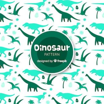 Padrão de silhuetas de dinossauro de mão desenhada