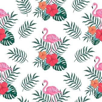 Padrão de verão tropical sem costura com flores de hibisco e pássaros flamingo