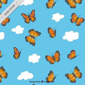 Padrão decorativo de nuvens e borboletas