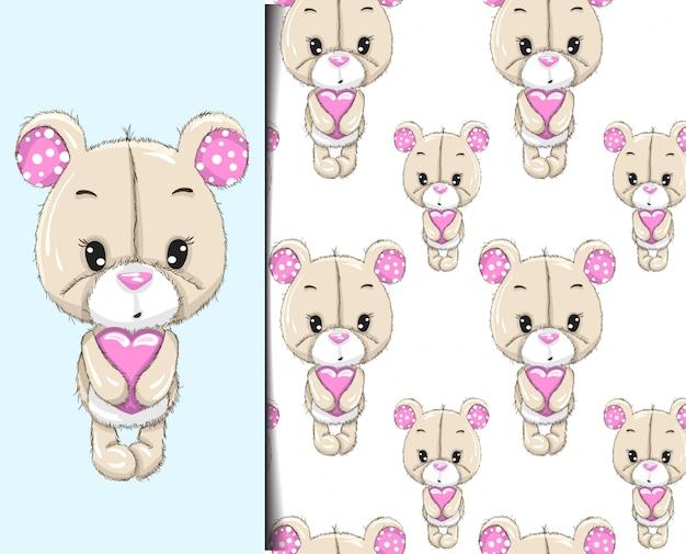Padrão e padrão pequeno urso segurando coração