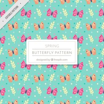 Padrão fantástico com rosa e laranja borboletas