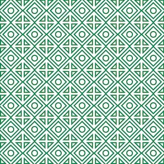 Padrão geométrico com losangos, círculos e triângulos.