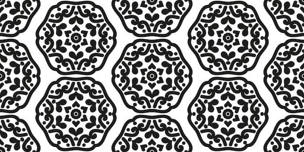 Padrão geométrico sem costura de mandalas simétricas preto e branco