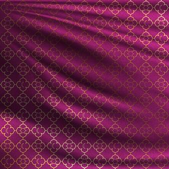 Padrão oriental dourado em tecido de seda ondulado
