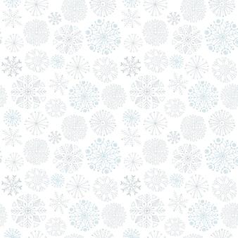 Padrão sem costura de flocos de neve. fundo de inverno. design de papel de embrulho de design de natal e ano novo.