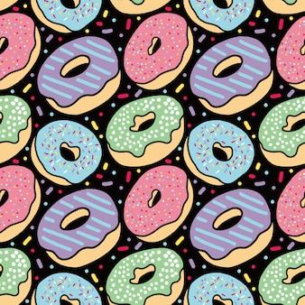 Padrão sem costura do bolo donut delicioso em fundo preto