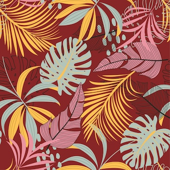 Padrão sem emenda abstrato brilhante com folhas tropicais coloridas e plantas em vermelho