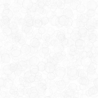 Padrão sem emenda abstrato de círculos translúcidos distribuídos aleatoriamente nas cores branco e cinza
