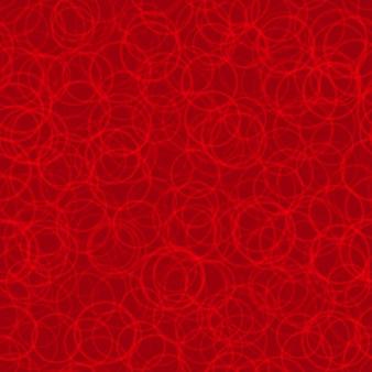Padrão sem emenda abstrato de contornos de círculos dispostos aleatoriamente em cores vermelhas