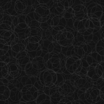 Padrão sem emenda abstrato de contornos de círculos dispostos aleatoriamente nas cores preto e cinza