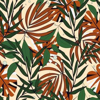 Padrão sem emenda abstrato de tendência com folhas tropicais coloridas e plantas em fundo bege
