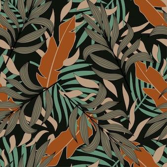 Padrão sem emenda abstrato original com folhas e plantas tropicais coloridas sobre um fundo escuro