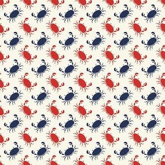 Padrão sem emenda com caranguejos vermelhos e azuis em fundo branco.