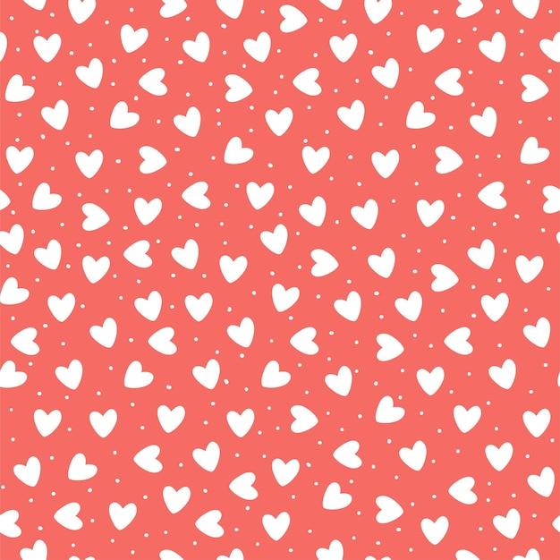 Padrão sem emenda com corações simples desenhados à mão ehite em fundo rosa coral.