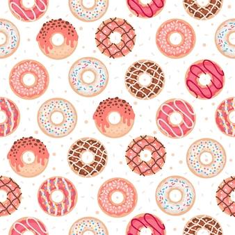 Padrão sem emenda com donuts coloridos com esmalte e granulado em um fundo branco.