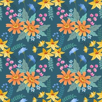 Padrão sem emenda com flores coloridas sobre fundo azul.