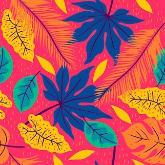 Padrão sem emenda com folhas tropicais em um fundo rosa.