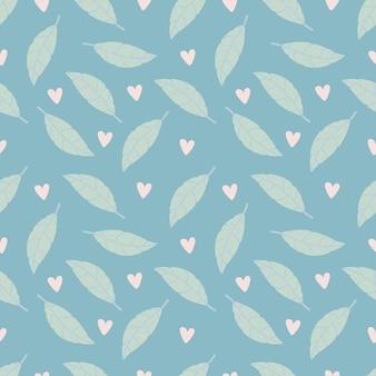 Padrão sem emenda com folhas verdes e corações rosa sobre fundo azul
