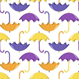 Padrão sem emenda com guarda-chuvas amarelos e roxos brilhantes em um fundo branco. impressão fofa de outono para têxteis, papel de embrulho e design