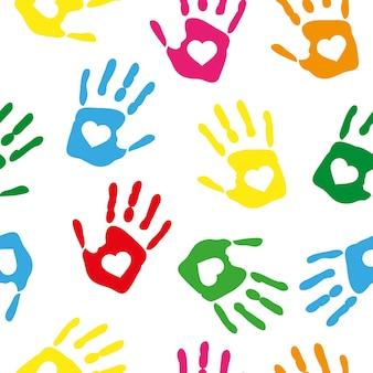 Padrão sem emenda com impressões de mão colorida de arco-íris com corações brancos em fundo branco. ilustração vetorial.