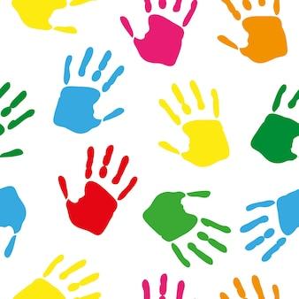 Padrão sem emenda com impressões de mão colorida de arco-íris em fundo branco. ilustração vetorial.