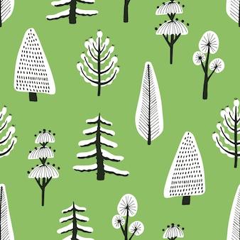 Padrão sem emenda com mão diferente desenhadas árvores de inverno cobertas de neve sobre fundo verde.