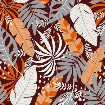 Padrão sem emenda com plantas e folhas tropicais marrons