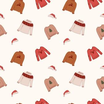 Padrão sem emenda com suéteres de natal e chapéus de papai noel
