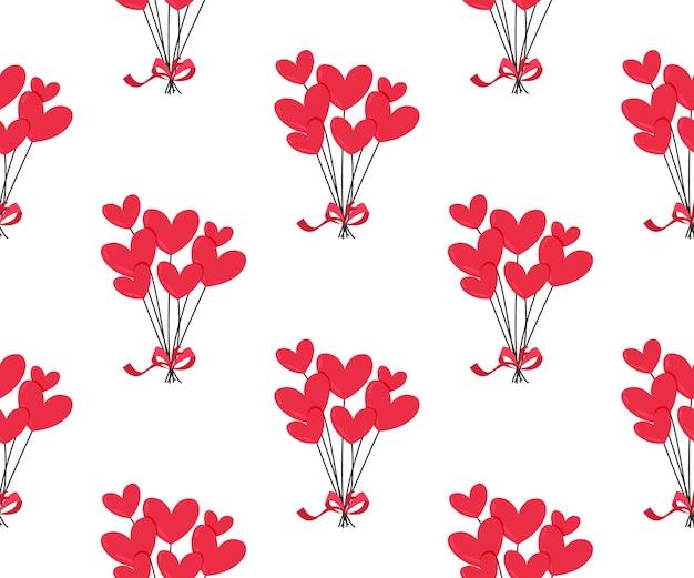 Padrão sem emenda de balões de coração vermelho.