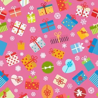 Padrão sem emenda de caixas de presente coloridas em fundo rosa
