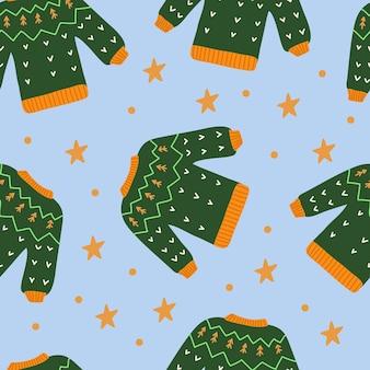 Padrão sem emenda de camisola sobre um fundo azul. cores verdes, amarelas e azuis. coleção outono e inverno. ilustração em vetor mão desenhada.