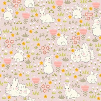 Padrão sem emenda de coelhinhos de primavera com flores.