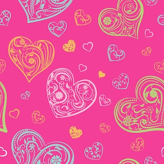 Padrão sem emenda de corações grandes e pequenos com ornamentos de cachos, flores e folhas, multicoloridos em rosa
