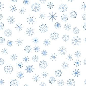 Padrão sem emenda de diferentes flocos de neve em um fundo branco.