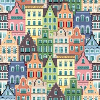 Padrão sem emenda de fachadas de desenhos animados de casas antigas de holanda. arquitetura tradicional da holanda. ilustração plana colorida no estilo holandês.