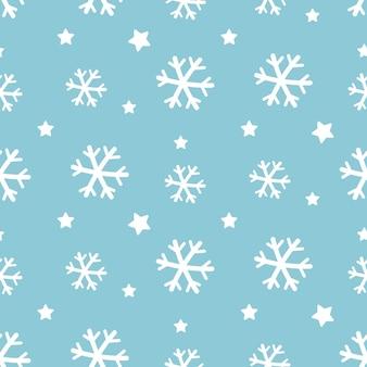 Padrão sem emenda de flocos de neve brancos sobre fundo azul.
