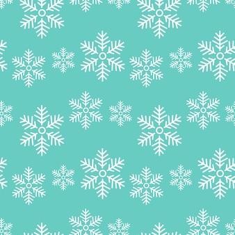 Padrão sem emenda de flocos de neve em um fundo azul