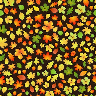 Padrão sem emenda de folhas de outono amarelas, laranja e verdes em fundo preto