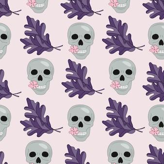Padrão sem emenda de halloween crânio e folhas