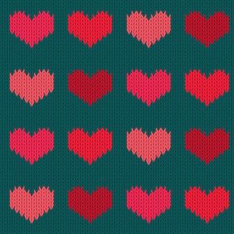 Padrão sem emenda de lã tricotado com corações em tons de rosa. dia dos namorados