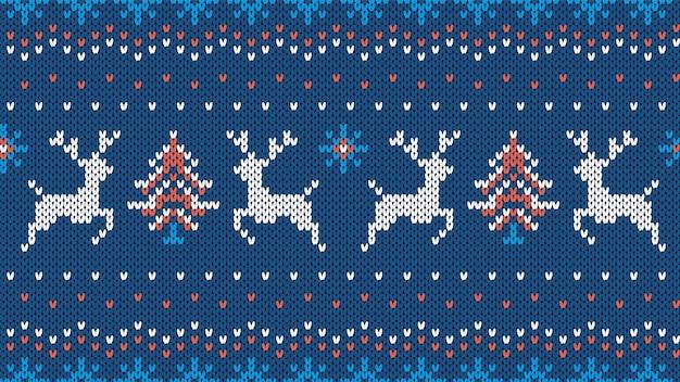 Padrão sem emenda de malha. textura de natal com veados, árvore, flocos de neve. fundo de camisola azul.