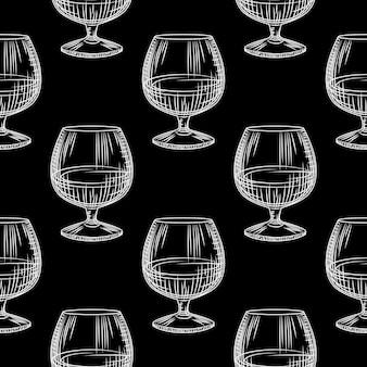 Padrão sem emenda de mão desenhada copo de vidro. copo de conhaque ou conhaque em fundo preto.