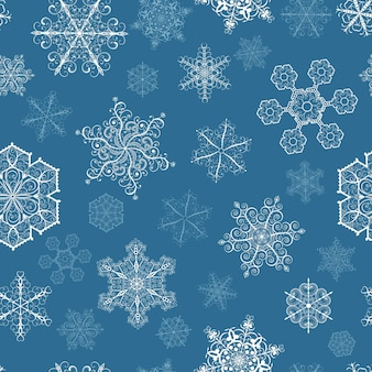 Padrão sem emenda de natal com flocos de neve brancos grandes e pequenos em fundo azul escuro